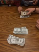 Counting money from ticket sales for our school play